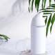White shaving foam or cleaning lotion bottle mock up on a marble table with evergreen palm leaves - PhotoDune Item for Sale