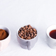 Three cups of different condition of coffee - beans, freshly ground and coffee drink on a marble - PhotoDune Item for Sale