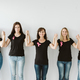 Five women in black tshirts and blue jeans standing together - PhotoDune Item for Sale
