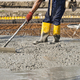 a bricklayer who level the freshly poured concrete to lay the foundations of a building - PhotoDune Item for Sale