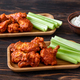 Buffalo wings with fresh celery stalks - PhotoDune Item for Sale