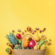 Exotic fruits in straw summer bag on yellow background. Top view. Copy space. Tropical fruits flat - PhotoDune Item for Sale