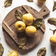Yellow apples on a sliced board in vintage style. leaves, food, wholesome food, vegan, farm product - PhotoDune Item for Sale