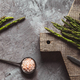 Asparagus on a cutting board. Healthy food, health on a concrete background - PhotoDune Item for Sale