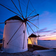 Traditional greek windmills on Mykonos island at sunrise, Cyclades, Greece - PhotoDune Item for Sale