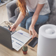 Woman freelancer uses a household humidifier in the workplace to maintain relative humidity - PhotoDune Item for Sale