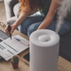 Woman freelancer uses a household humidifier in the workplace at home office with laptop - PhotoDune Item for Sale