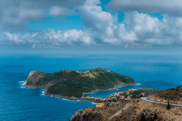 Picturesque view of Assos village and blue sea bay. Stunning cloudscape above the penincula - Stock Photo - Images