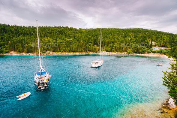 Foki beach near small town Fiskardo at Kefalonia, Ionian islands, Greece. Private yacht boats in the - Stock Photo - Images