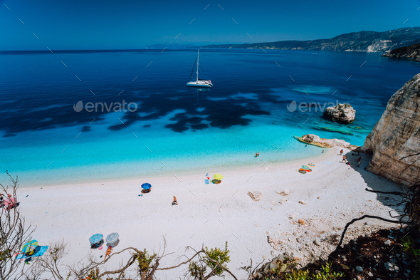 Fteri beach, Cephalonia Kefalonia, Greece. White catamaran yacht in clear deep blue sea water with - Stock Photo - Images