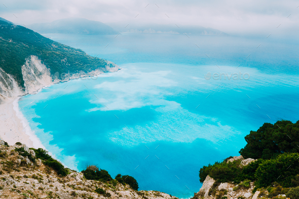 Azure water of Myrtos Beach, Kefalonia Island. Best beaches in the world and the Mediterranean - Stock Photo - Images