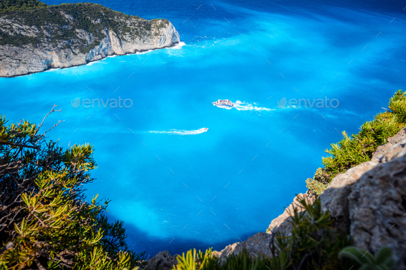 Navagio beach, Zakynthos, Greece. Tourist trip boats visiting and leaving Shipwreck bay with - Stock Photo - Images