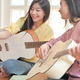Teenage girls and friends playing guitar and using a smartphone video call. - PhotoDune Item for Sale