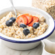Bowl of oatmeal porridge with strawberries and blueberries. - PhotoDune Item for Sale