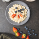 Plate of oatmeal porridge with strawberries and blueberries. - PhotoDune Item for Sale
