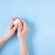 Female Hands Holding The Soap, Blue Background - PhotoDune Item for Sale