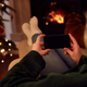 Woman At Home Using Mobile Phone With Blank Screen At Christmas - PhotoDune Item for Sale