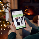 Woman At Home Using Digital Tablet To Shop For Clothes Online At Christmas - PhotoDune Item for Sale