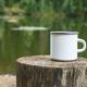 White enamel mug mockup with tree stump - PhotoDune Item for Sale