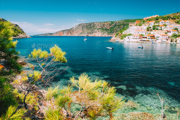 Mediterranean town Assos in calm sea cove and mountain coast at Kefalonia Island, Greece - Stock Photo - Images