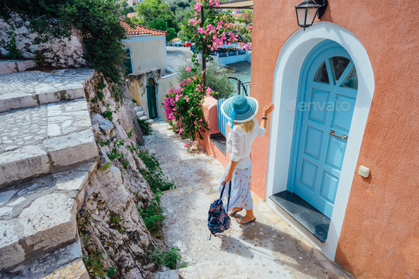 Adult female on summer vacation in Greece looking towards wonderful summer day. Cute woman leaving - Stock Photo - Images
