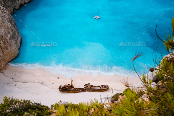Close up of Shipwreck in Navagio beach. Azure turquoise sea water and paradise sandy beach. Famous - Stock Photo - Images