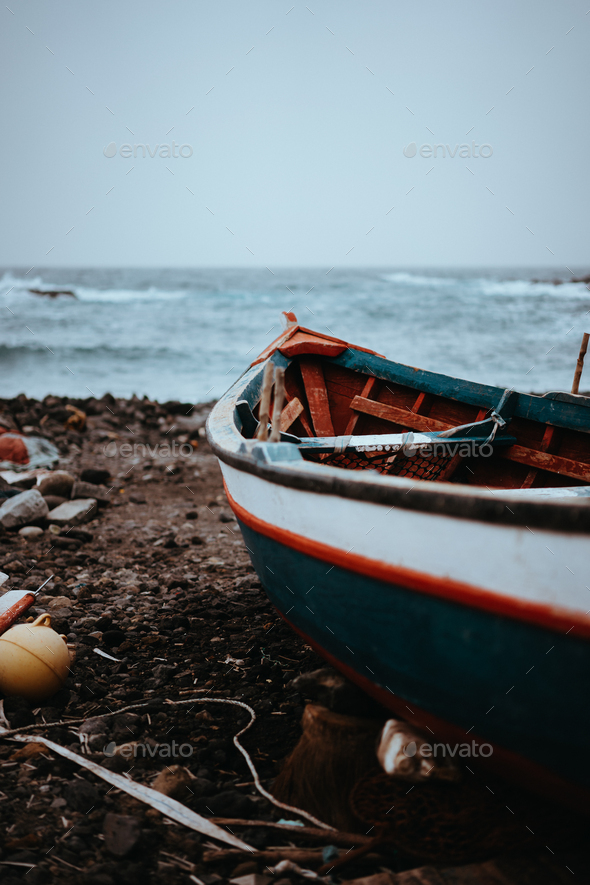 Fishing boat on shore during stormy Atlantic ocean. Sinagoga location on Santo Antao Island. Cape - Stock Photo - Images