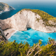 Navagio beach vintage look. Waved bay water and abandoned shipwreck on the beach. Zakynthos Island - PhotoDune Item for Sale