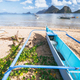 Traditional banca boat at Las cabanas beach in front of shallow lagoon of scenery in El Nido - PhotoDune Item for Sale
