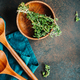 Wooden kitchen tools and bowl with fresh greens. - PhotoDune Item for Sale