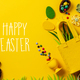 Felt Easter decorations and sweets on yellow background - PhotoDune Item for Sale
