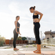 Two young girls practicing stretching and yoga workout exercise together - PhotoDune Item for Sale
