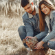 Cute couple in a jeans clothes in a spring field - PhotoDune Item for Sale