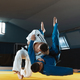 Two young judo fighters in kimono training martial arts in the gym with expression, in action and - PhotoDune Item for Sale