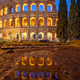 The illuminated Colosseum in Rome at twilight - PhotoDune Item for Sale