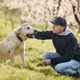 Man with dog in spring nature - PhotoDune Item for Sale