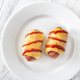 Sausage rolls on the white plate - PhotoDune Item for Sale