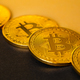 Closeup Of Shiny Bitcoin Crypto Currency Coins on Black and Yellow - PhotoDune Item for Sale