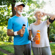 Running mature couple congratulate and happy to finish their morning workout - PhotoDune Item for Sale