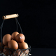 Basket with close up fresh farm natural chicken eggs on a black background. Farm eco friendly - PhotoDune Item for Sale