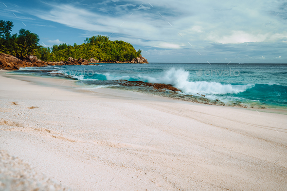 Wave hitting old corals coast at beautiful beach Anse Bazarca, seychelles - Stock Photo - Images