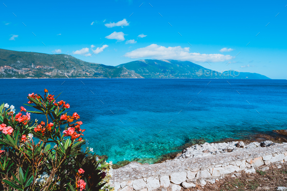Panorama of crystal clear transparent blue turquoise teal Mediterranean seascape in Fiskardo town - Stock Photo - Images