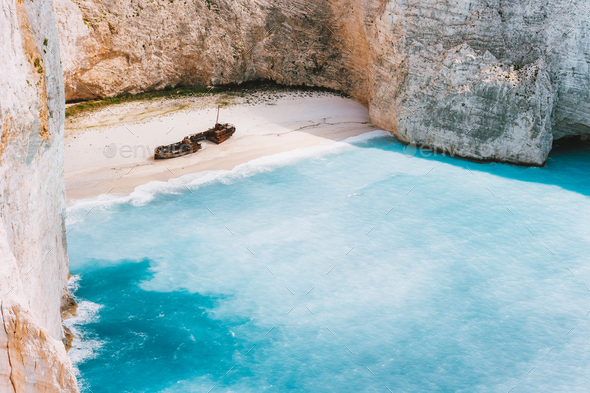 Navagio beach with turquoise blue sea water surrounded by huge white limestone cliffs. Famous - Stock Photo - Images