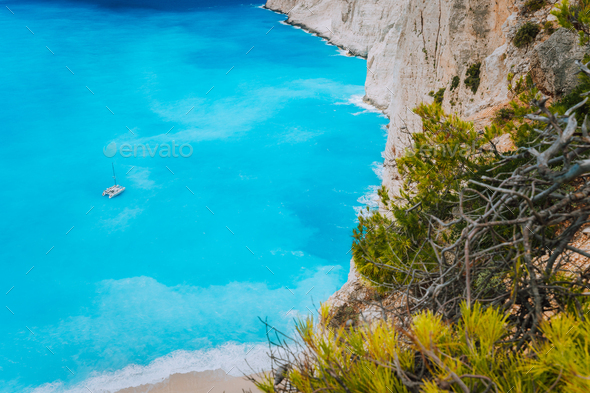 Lonely catamaran yacht in blue bay of Navagio beach. Azure turquoise sea water pattern near paradise - Stock Photo - Images