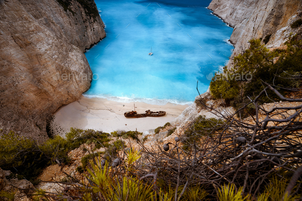 Shipwreck in Navagio beach. Azure turquoise sea water surrounded by huge rocks. Famous tourist - Stock Photo - Images