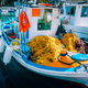 Traditional colorful fishing boat in the sea, Greece. Sunny summer day - PhotoDune Item for Sale