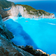 Navagio beach or Shipwreck bay with turquoise water and pebble white beach. Famous landmark location - PhotoDune Item for Sale