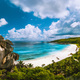 Panoramic view of beautiful Grand Anse beach on La Digue island in Seychelles. Blue lagoon with - PhotoDune Item for Sale