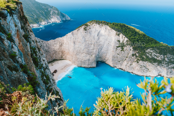 Navagio beach or Shipwreck bay. Turquoise water and pebble white beach in morning light. Famous - Stock Photo - Images