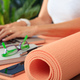 Woman and an exercise mat, corporate office background - PhotoDune Item for Sale
